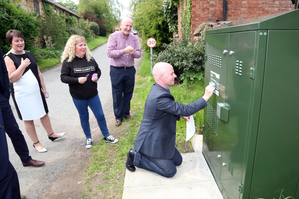 Holwell gets superfast broadband... Holwell village Digital Champion Simon Wilkinson-Blake adds a sticker to the box